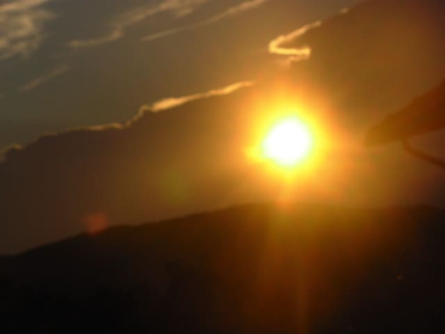 Vista con tramonto dal terrazzino della casa