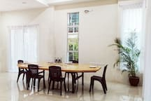 Spacious living room & custom made dining table can comfortably sit 12 people or its a perfect for group meeting