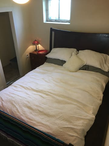 Bsmt Bdrm Crash Pad Close to I-80, Downtown, & UW