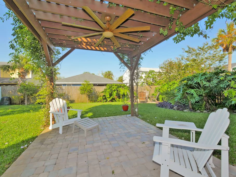 Backyard with pergola, fire pit, and outdoor shower
