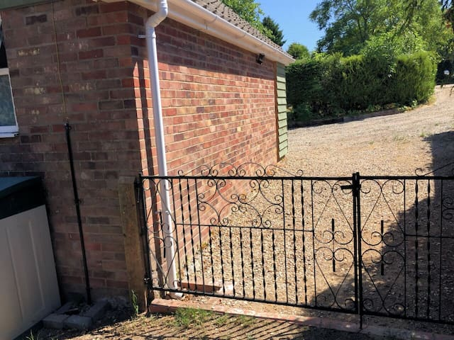 Ample parking for two vehicles at the side of the property. Secure gate also wired at the bottom for the safety of your dog.