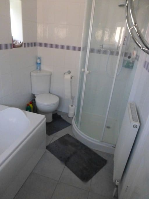 Clean, well appointed bathroom with separate shower.