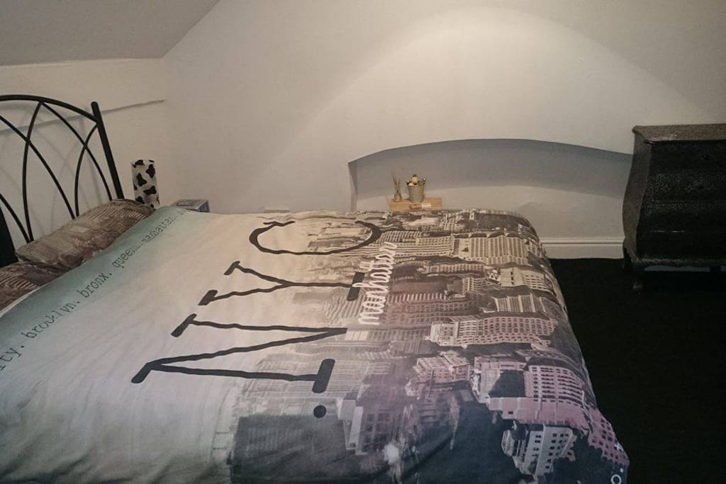 Lovely spacious double bedroom.  Room has toiletries, chest of drawers, bookcase, bedside tables and wardrobe.