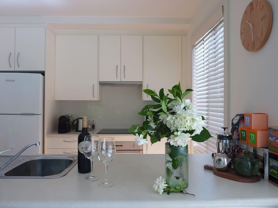 Modern light filled galley kitchen with garden view