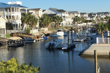 Canal Front Home with Boat Access & Golf Cart!