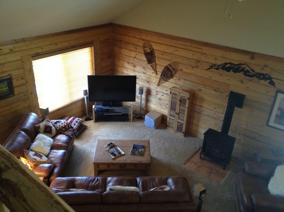 Large flat screen TV, sound system, leather furniture, plush new carpeting