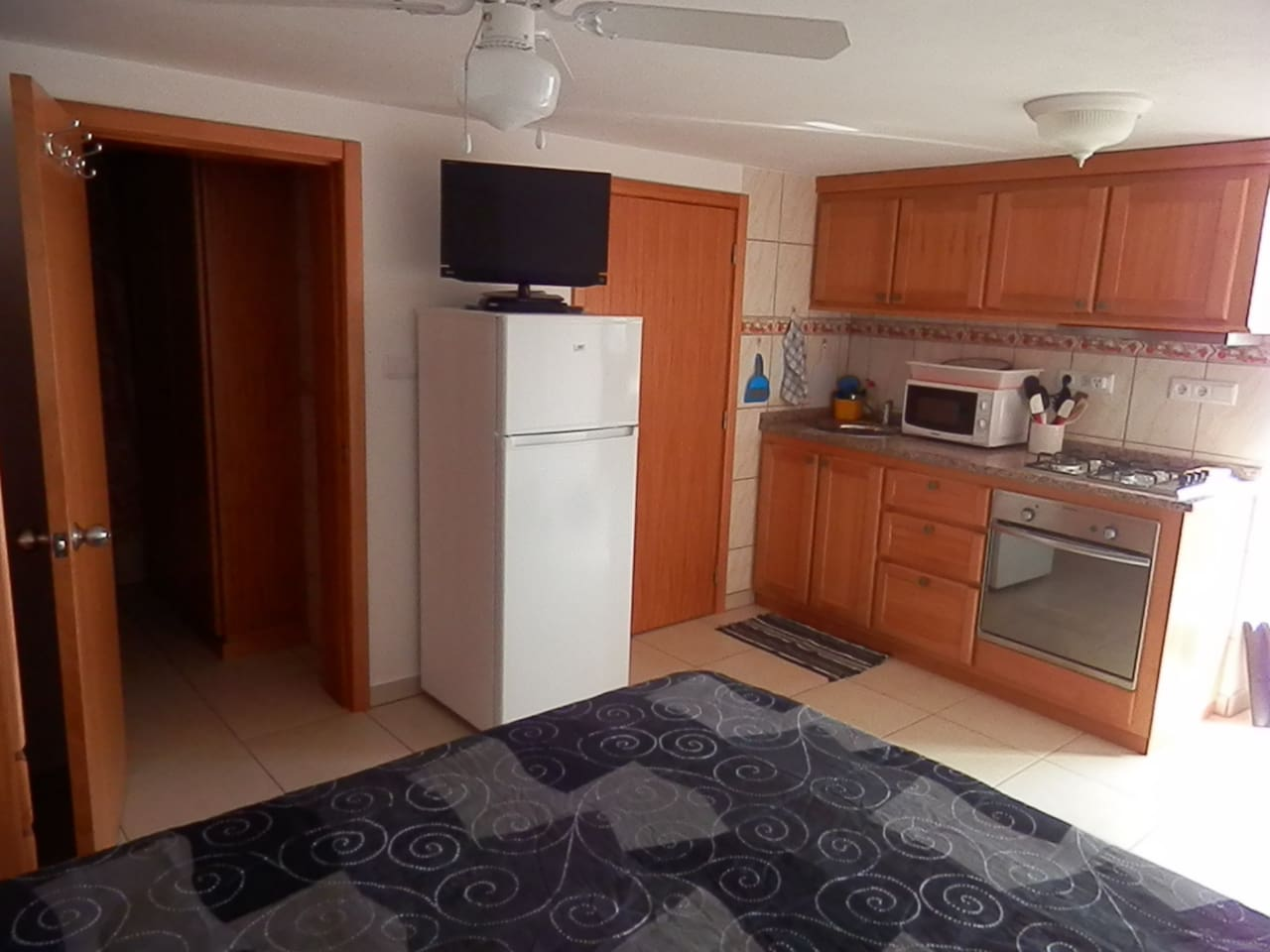 New small apartment with private bath and small kitchen.  It has television and dvr and, we have a good collection of movies.