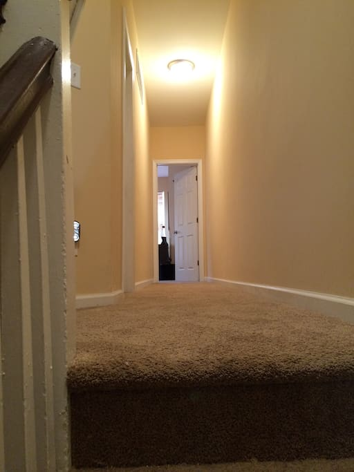 Hallway which leads to both bedrooms.