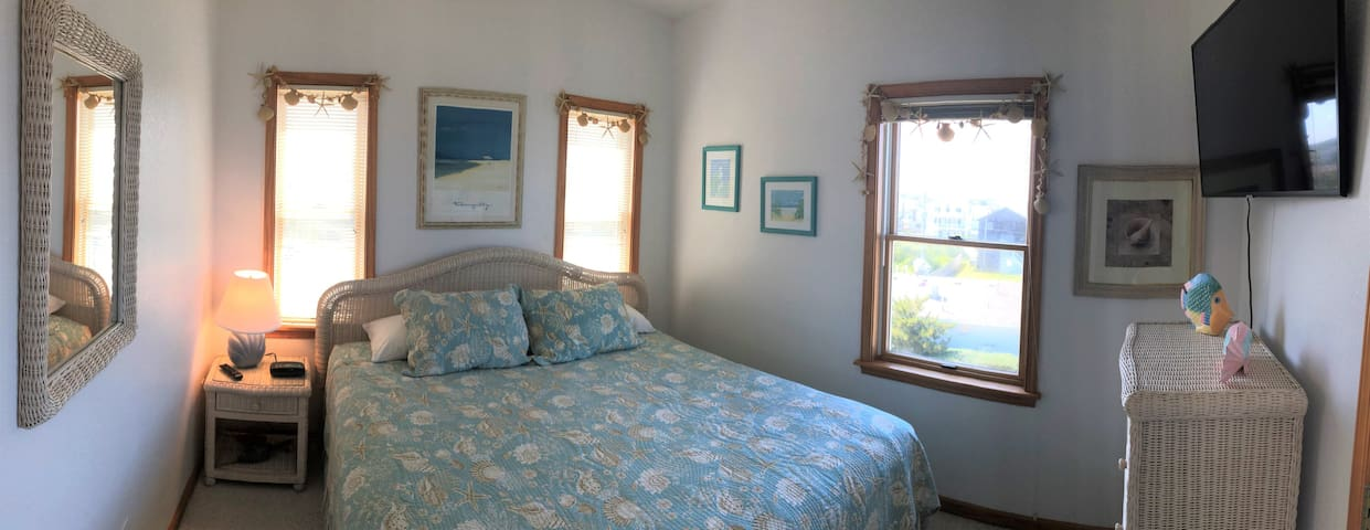 This is the quiet, second King bedroom. Ocean and Wright Memorial views. Big TV!