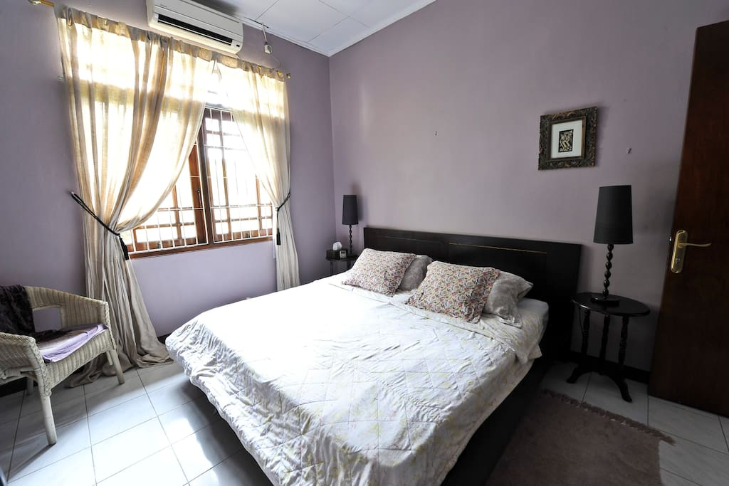 Guest bedroom with air-con, king sized bed, cotton bedding & lockable door