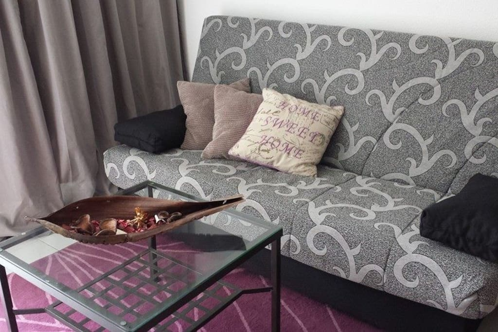 the collapsible sofa with coffee table in the living room