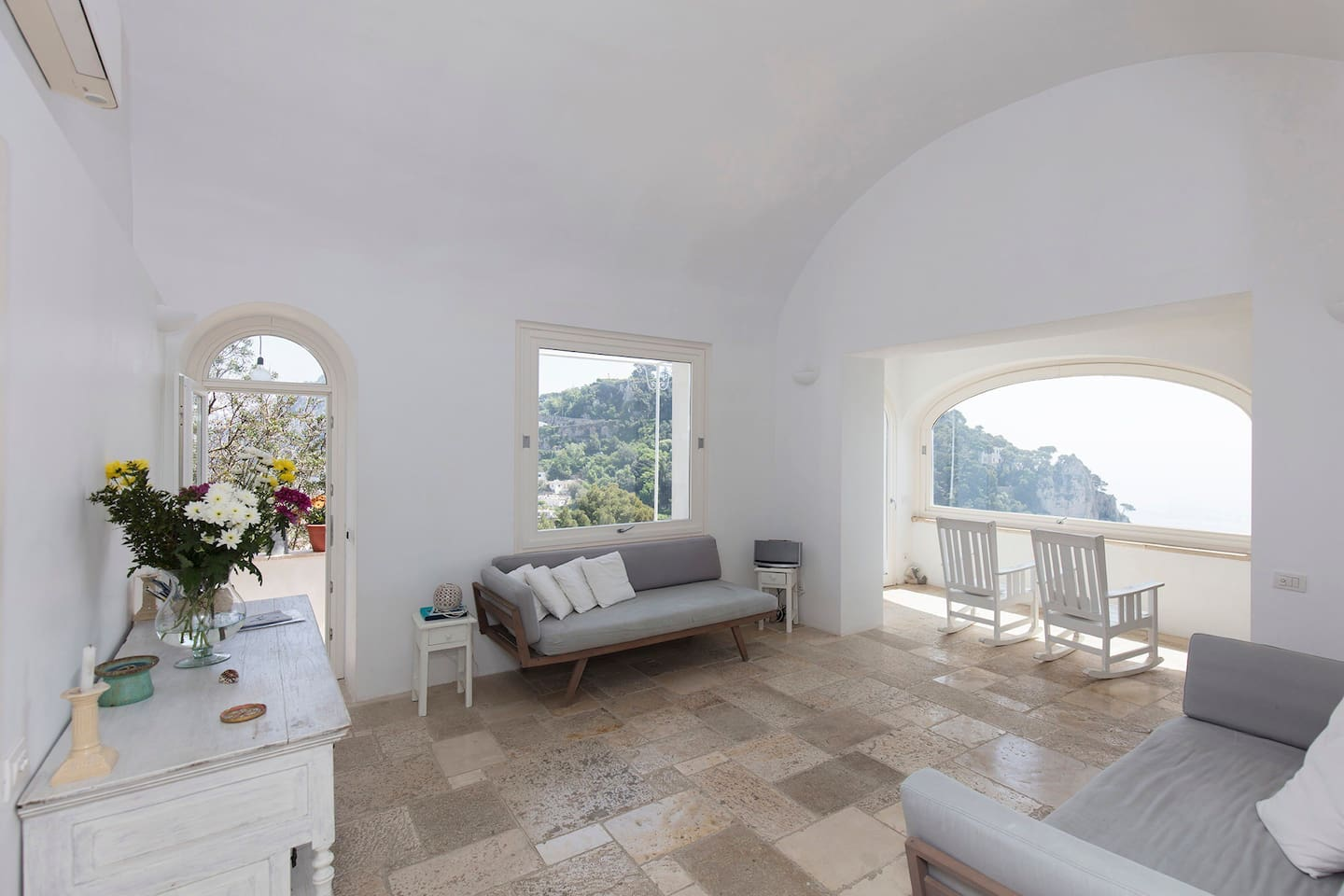 The huge living room with a breathtaking sight on the see of Marina Piccola and on Capri town and the other golfo from the top