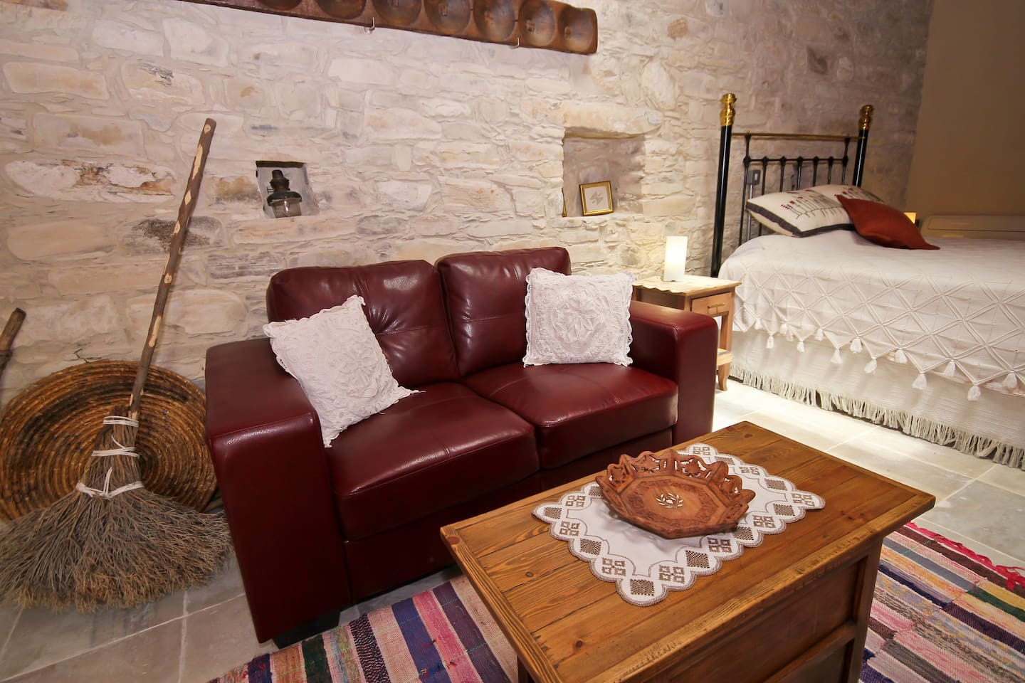 The sitting and sleeping area features several traditional Cypriot items.