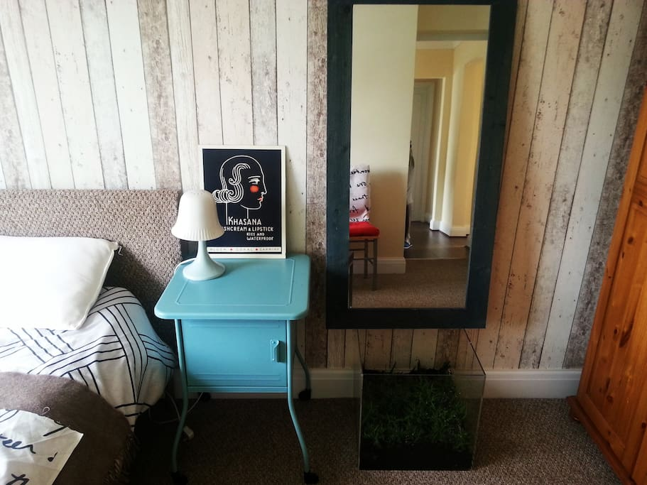 Mint green bedside cabinet with a small box of green in the Bedroom