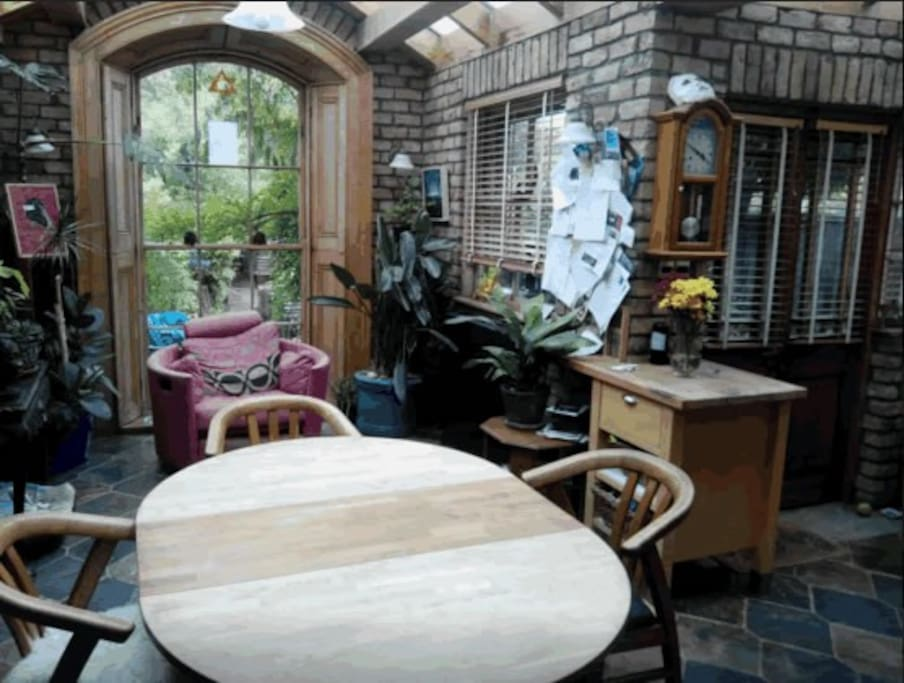 Bright Dinning/Kitchen area leading to enclosed garden