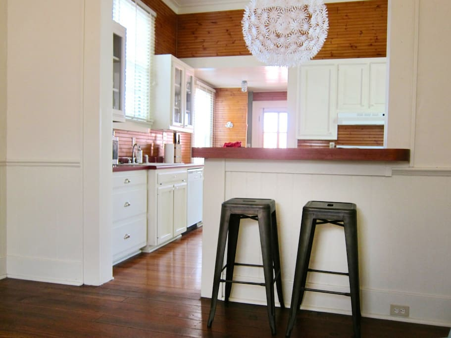 Full Kitchen with breakfast bar overlooking the living room. Great for entertaining.