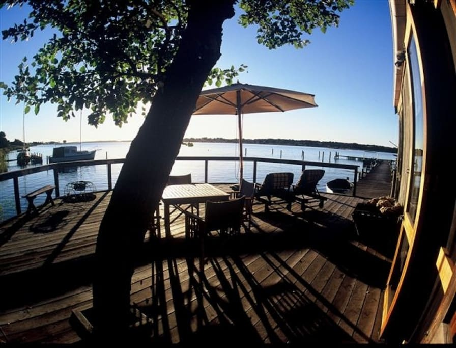 Private deck with alfresco settings overlooking the water