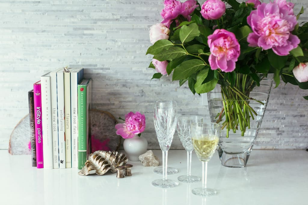 Peonies bloom in the late Spring.  The porch is perfect for a glass of wine.