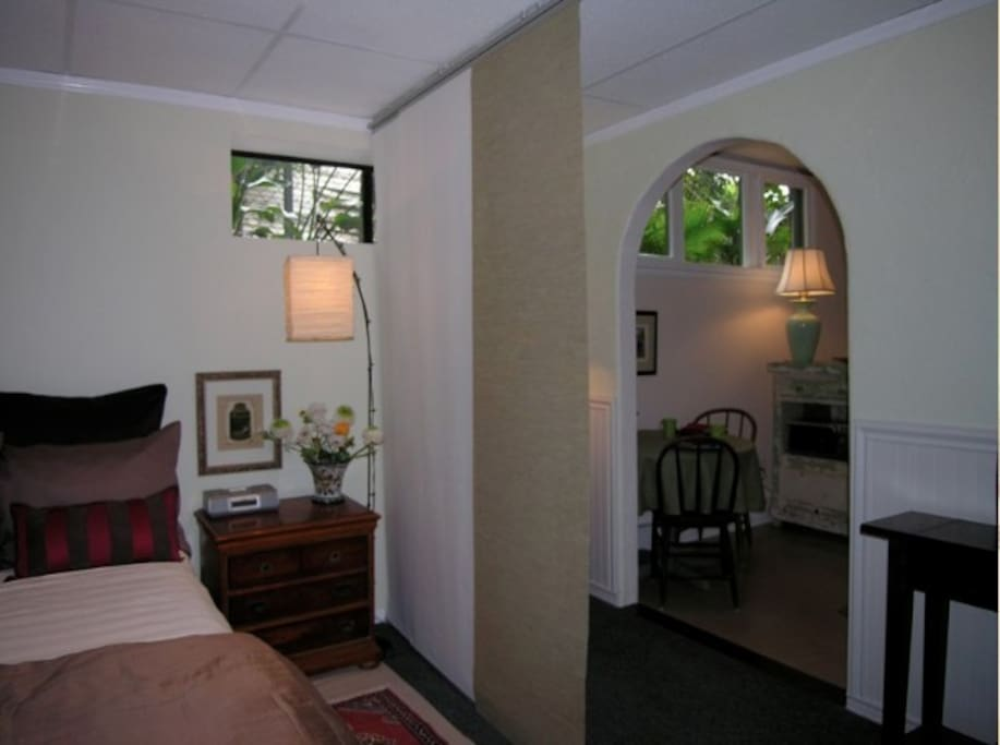 Simple elegant divider between bed and kitchen area.