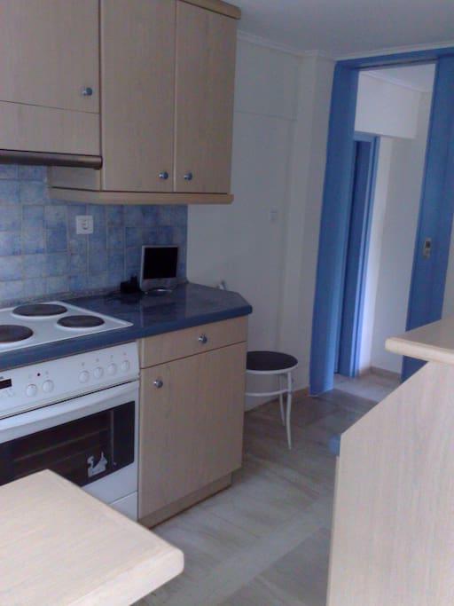 Κουζίνα ενιαία στον χώρο με πάσσο