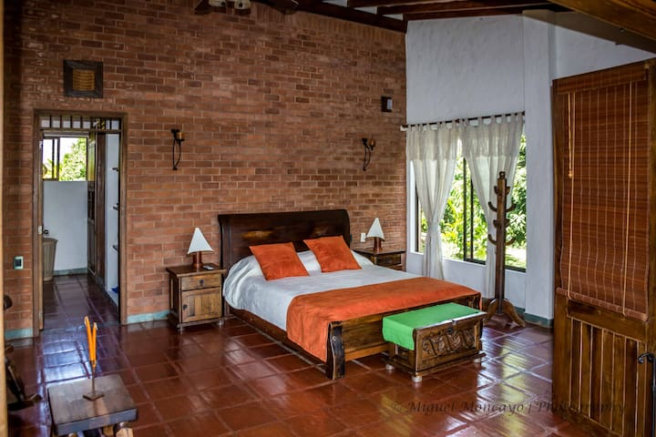 Main Master Bedroom in second floor: 1 king bed and 1 double rollaway bed
