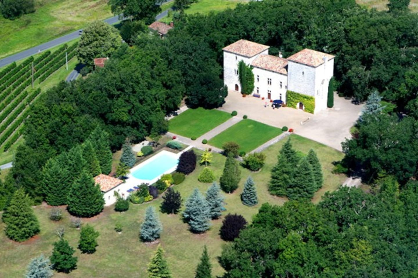 Aerial view of chateau, pool and park