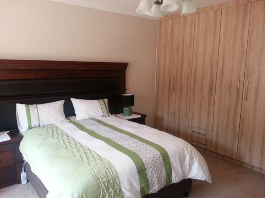 Queen size bed . Built-in wardrobes and lots of storage space.