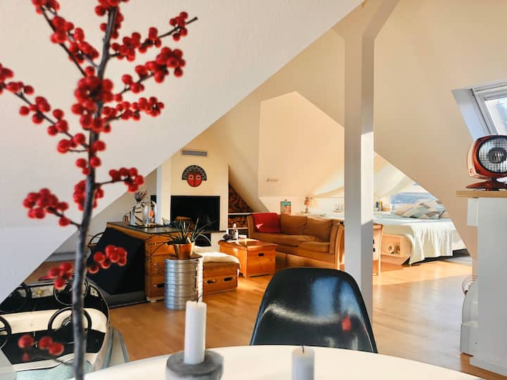 Design-Loft with open fireplace and three balconys