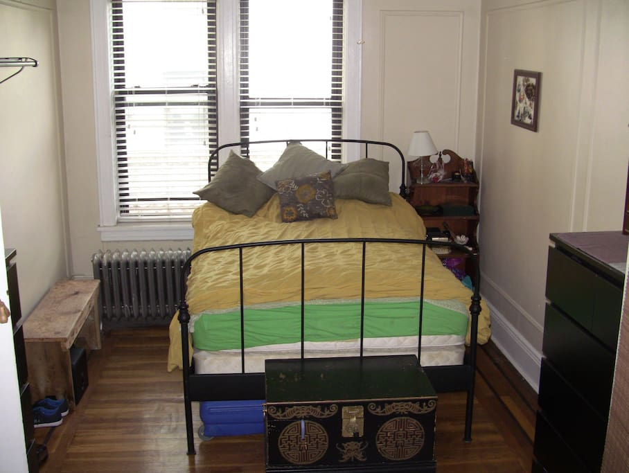 Large bedroom.  Cozy bed with lots of natural sunlight