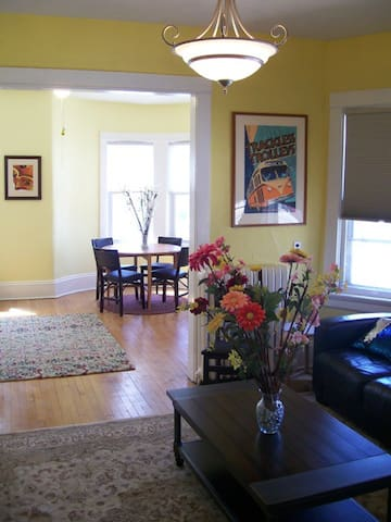 Surprisingly spacious living room and dining room with large windows overlooking the corner