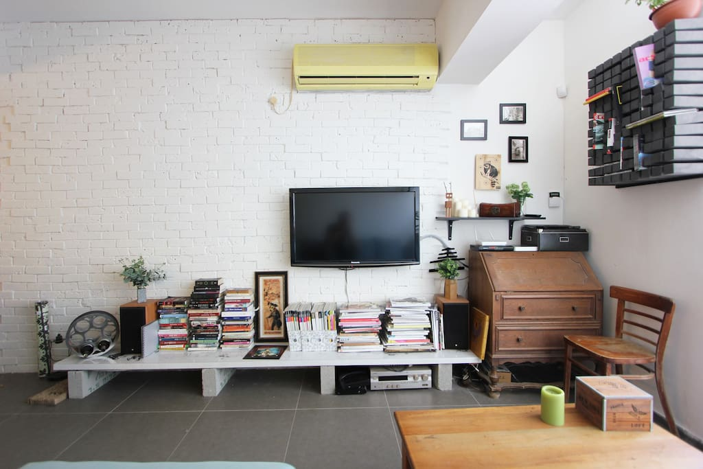 air conditioning, tv, exposed brick wall