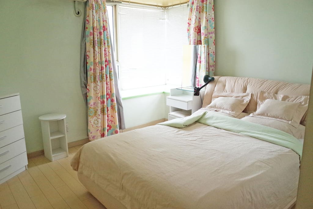 Master bedroom with dressing table and side table