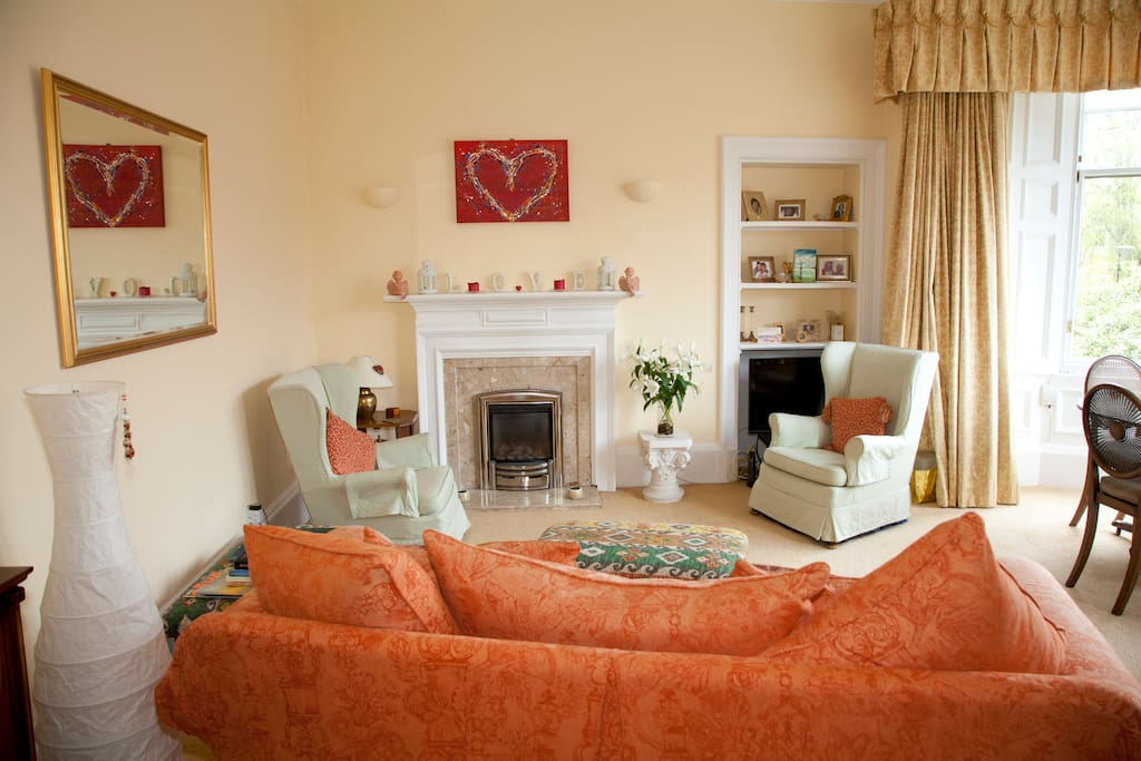 Lovely large sitting room with open views through the big bay window.