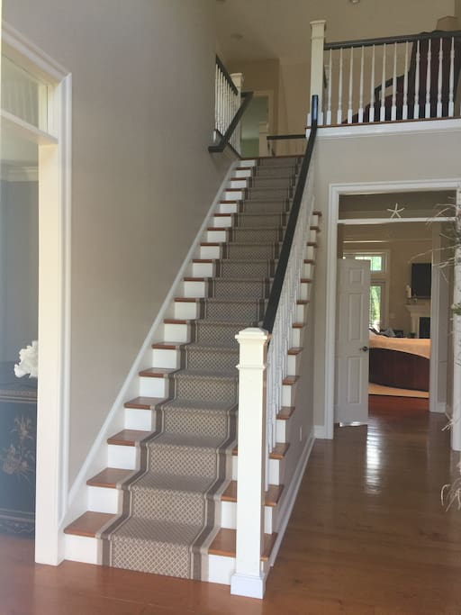 The staircase leading to the 2nd floor where the 4 bedrooms and 3 full bathrooms are located.