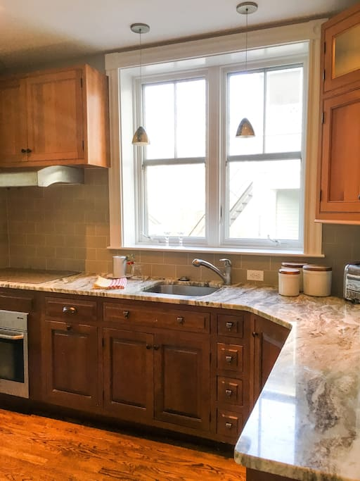 Cherry kitchen with induction cooktop, external vent fan, Miele convection oven, Bosch dishwasher. Fully equipped kitchen with microwave, coffee and espresso maker, rice cooker, toaster,  spices and all essential food preparation and serving supplies.