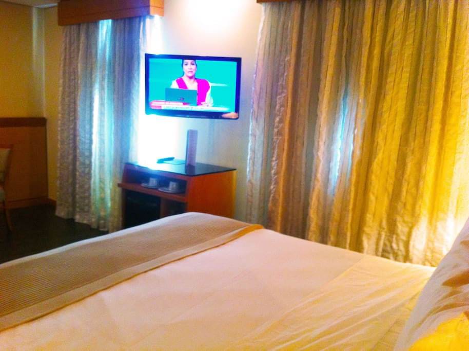 King Size bedroom, LCD Television and minibar.