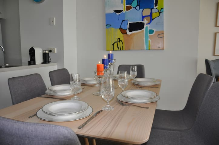 Dinning room, dinnerware and glass wear provided in the apartment.