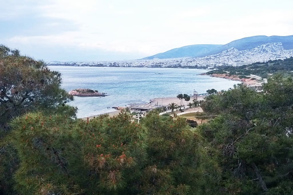 The sea bay of Kavouri, extends next to Vouliagmeni-apartment. Surrounded by a  a natural scenery  , of sea & pine trees. A suitable landscape,  for walking or jogging.