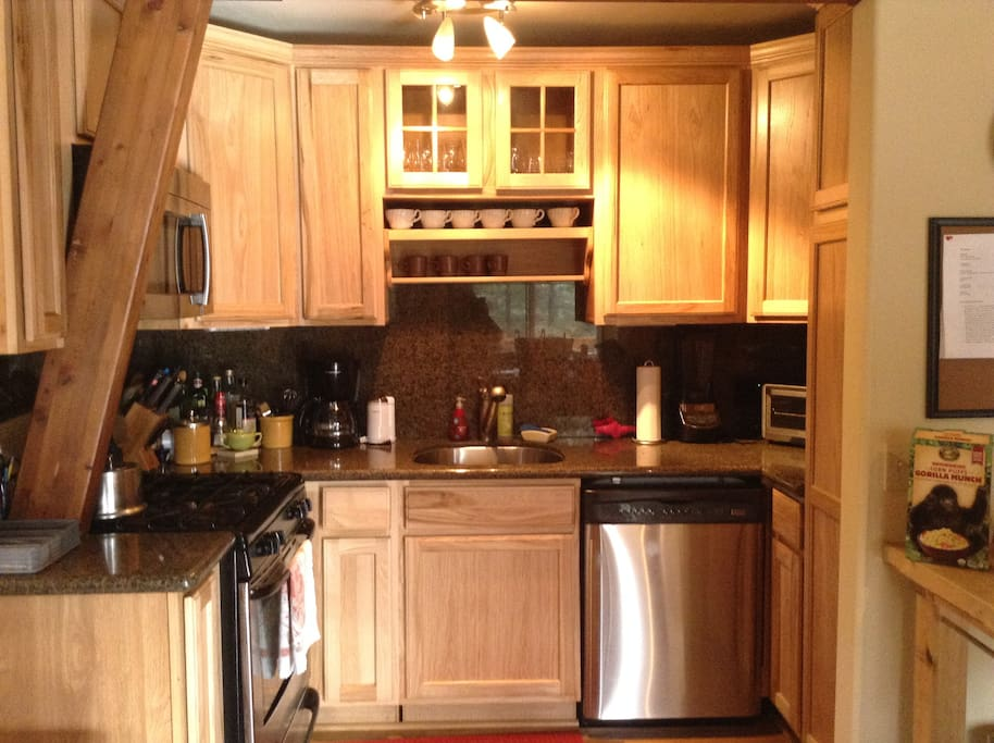 Galley kitchen with gas stove, dishwasher, blender, coffee maker, toaster oven and excellent kitchen equipment.