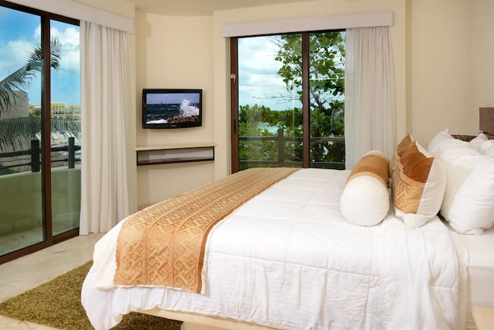 Master Bedroom with a King Size Bed and Cable TV
