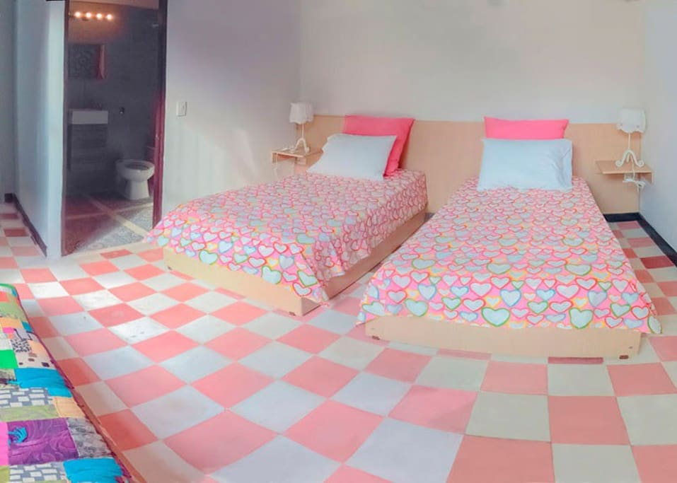 Pink room... In case you want to split the beds.... Not that we encourage to do that but there's always the option...