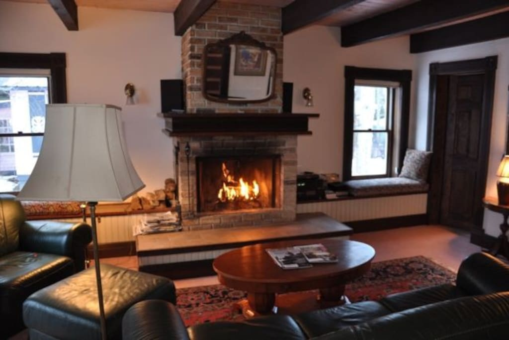 Comfortable living room with real wood burning fireplace, fire wood stacked next to the fire place, on the front porch with a face cord in the back yard; the couch, ottoman and chair have been upgraded to new (2016) buffalo hide sofa and chair