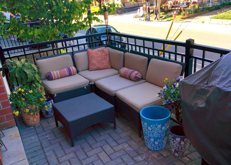 Enjoy the sunshine on your private balcony, weather-permitting! There is an outdoor sectional, as well as a table for two (not seen in photo).