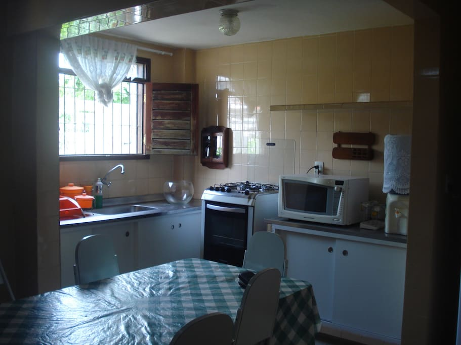 kitchen with fridge, oven, microwave
