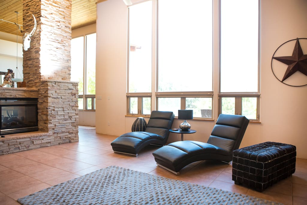Modern Décor Professionally decorated, cozy fireplace.