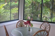 The Makai end of the shared screen porch. Each guestroom has its own table.