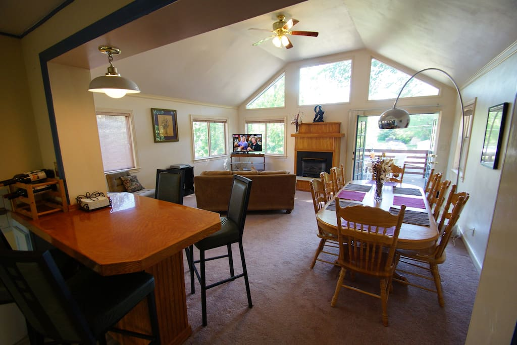 Large Great Room with breakfast Bar, dining table w/8 chairs, perfect for entertaining or just hanging out overlooking the foothills West of Golden.