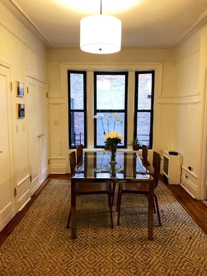 Dedicated dining room with charming pre-war details and room for four to sit comfortably.