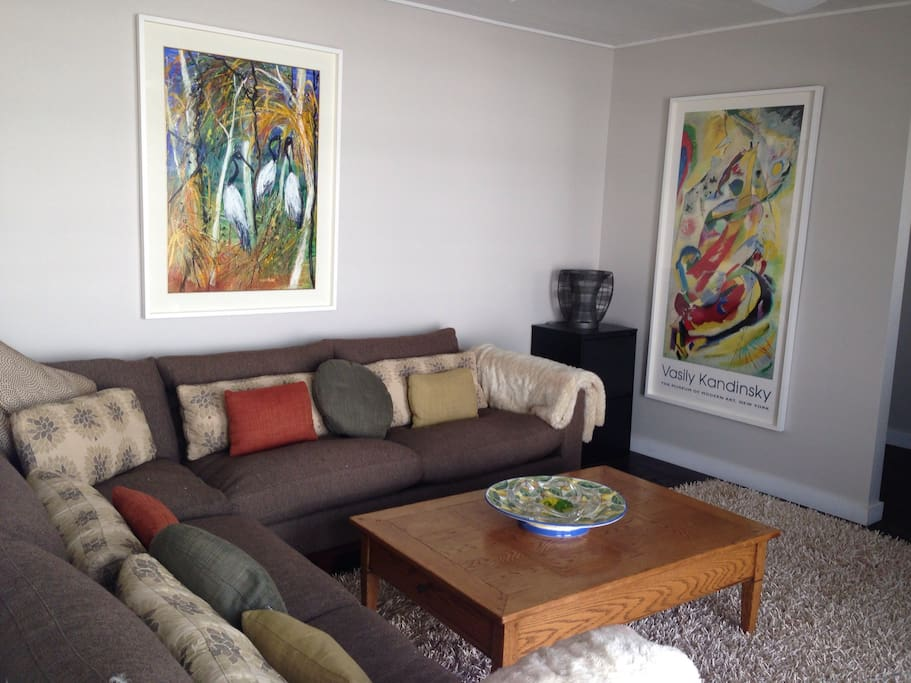 TV room with wrap around father down sofa with Big screen TV and IQ Foxtel