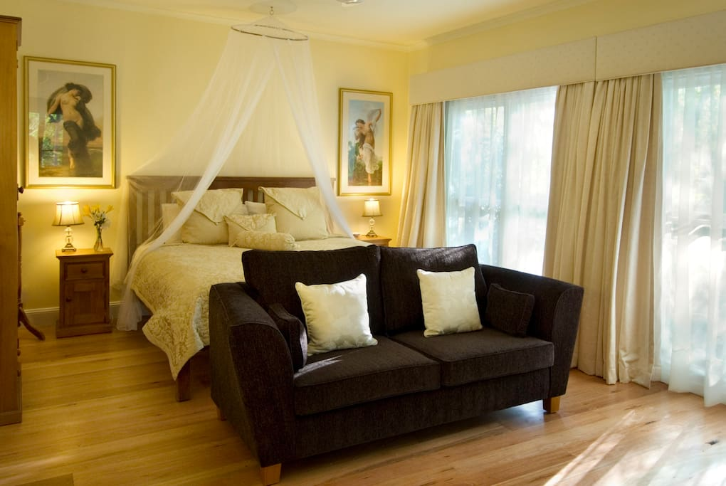 Beautiful spacious bedroom with king bed and wood fire